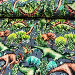 Dzianina pętelka drukowana 0,1 mb - dinozaury na zielonym